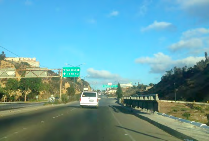 2. You will come over the hill and into the valley where you'll see signs for SAN DIEGO, INTERSTATE 5 directing you to the right.